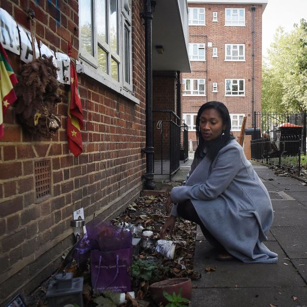Louise Samuel tends to a memorial to her brother Daniel Frederick, who was stabbed to death in London in January.