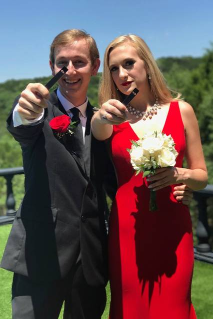Alex Knapp and Payton Hennessy hold up their Juuls at their senior prom in 2017.