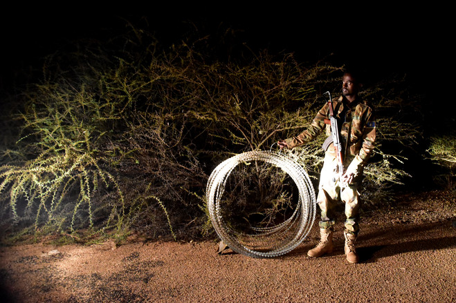 A Danab commando readies razor wire for a vehicle checkpoint.