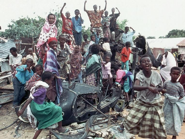 Young Somalis chanted anti-U.S. slogans while sitting atop one of two Black Hawk helicopters shot down in Mogadishu during a firefight with Somali guerrillas in October 1993.