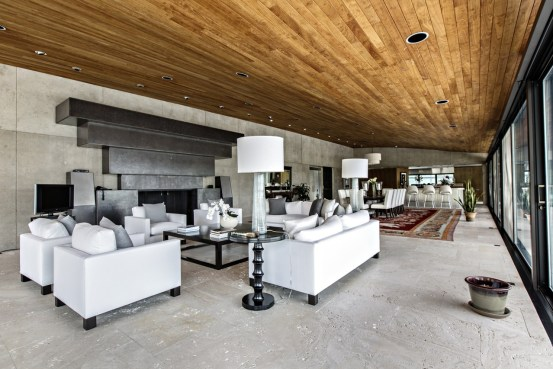 The home was designed by Rafael Viñoly, the architect behind the super-tall New York skyscraper 432 Park Avenue. The living-room area is shown.