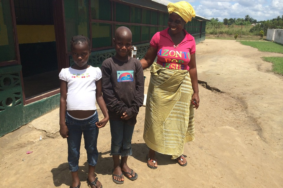 Feimata Dunoh at the re-opened orphanage she runs in Unification Town, Liberia. Esther Tokpah, in white shirt, and Gonda Gibson are two of the children who have come to the orphanage since the Ebola outbreak began.