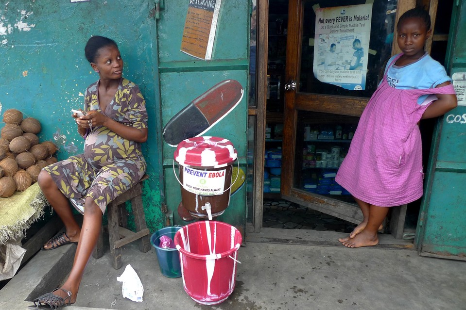 In West Point, the largest slum in Monrovia, Liberia's capital, many residents now use chlorinated water from buckets to wash their hands—one step toward preventing the spread of Ebola.