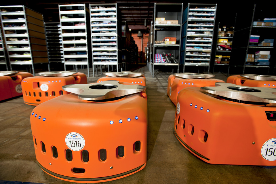 The orange, wheeled robots are the fruits of Amazon's 2012 purchase of Kiva Systems for $775 million.