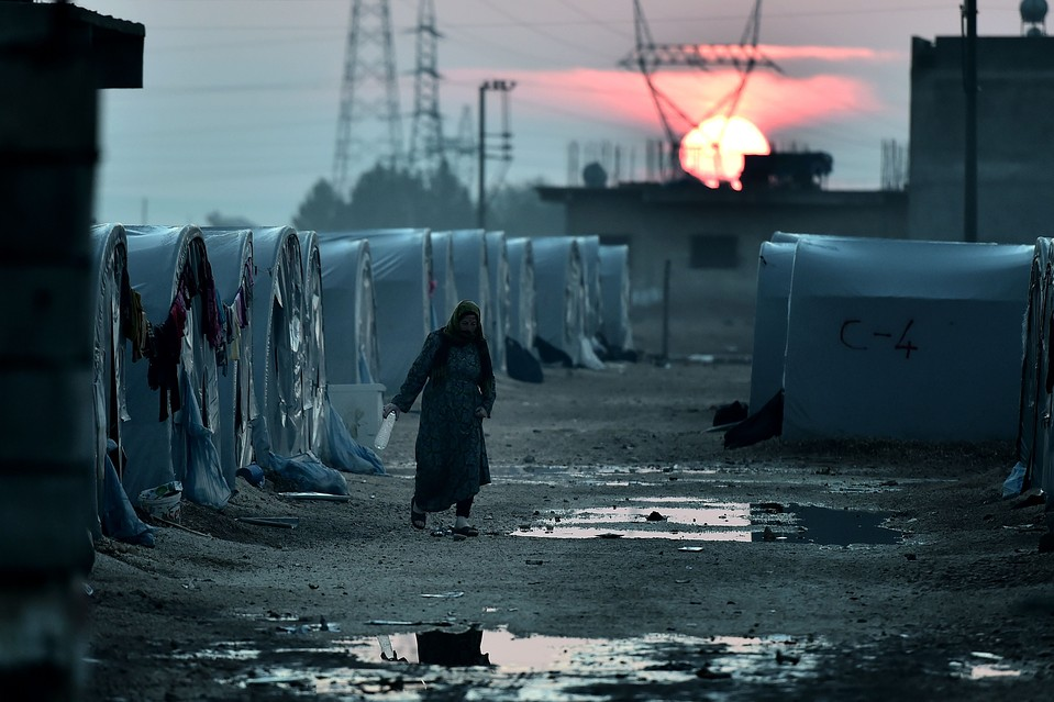 A Syrian Kurdish woman walks in a refugee camp in the town of Suruc, Sanliurfa province in Turkey, in October.