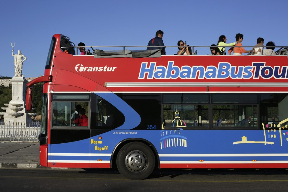 A tourist bus in Old Havana on Thursday. U.S. law forbids tourist travel to Cuba but several tour operators said business has been booming.