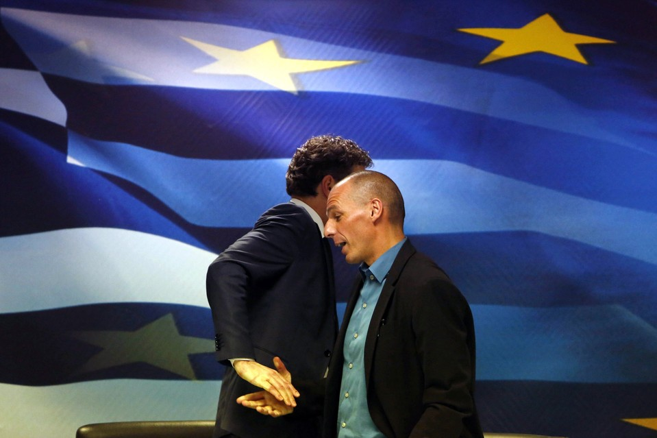 Jeroen Dijsselbloem, left, the head of the eurozone finance ministers' group, and Greek Finance Minister Yanis Varoufakis shake hands after a news conference in Athens on Friday.