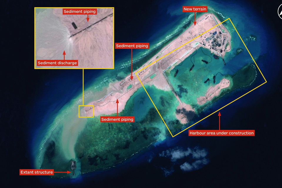 Now, Fiery Cross Reef has been transformed into an artificial island at least 3,000 yards long that experts say is big enough to include an airstrip and could become a Chinese command and control center for military operations in the area. Seen here in November.
