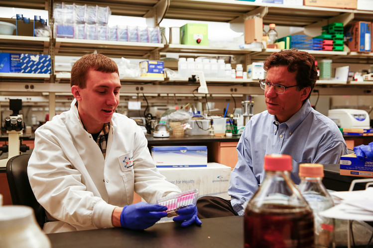 Lead author Michael Farzan, right, with Matthew Gardner in Dr. Farzan's lab at the Scripps Research Institute on Wednesday.