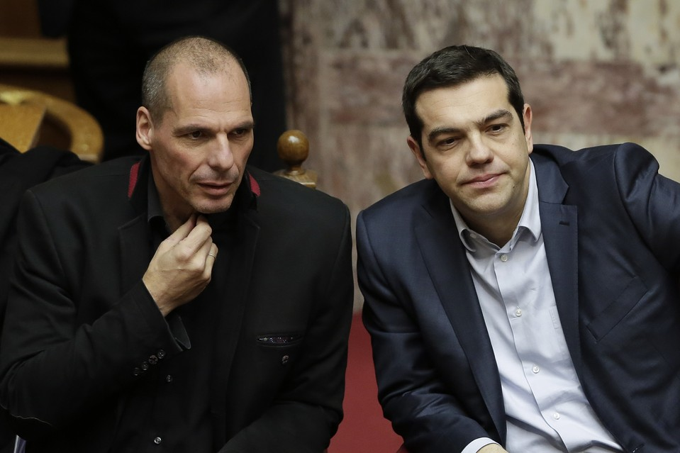 Greek Prime Minister Alexis Tsipras, right, and Finance Minister Yanis Varoufakis attend a presidential vote in Athens on Wednesday.