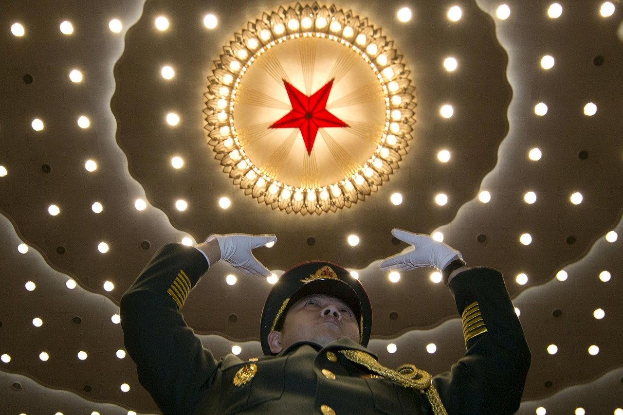 A military band conductor during the opening session of the National People's Congress on Thursday, at the Great Hall of the People, Beijing.