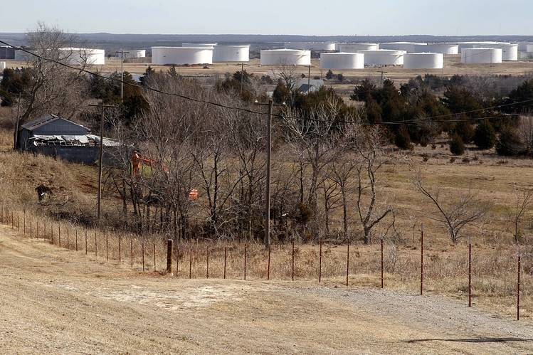 Oil storage in tanks on the edge of town in Cushing, Okla.