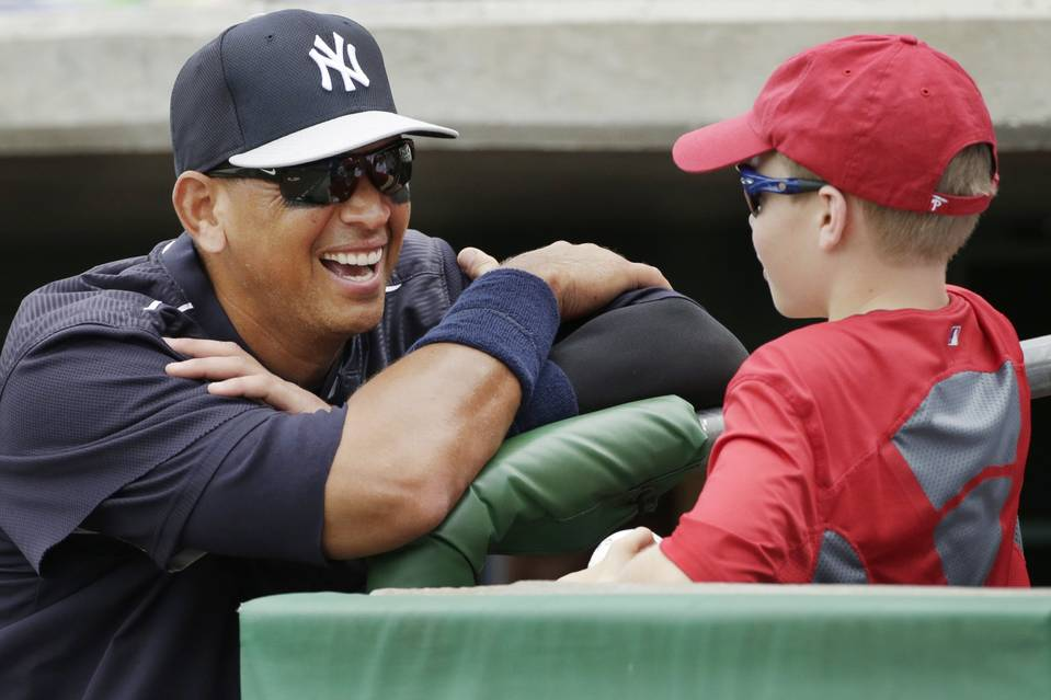 New York Yankees designated hitter Alex Rodriguez laughs as he talks with Spencer Woodall, 12, of Union, S.C., before the start of a spring training baseball game in Clearwater, Fla., on Friday.
