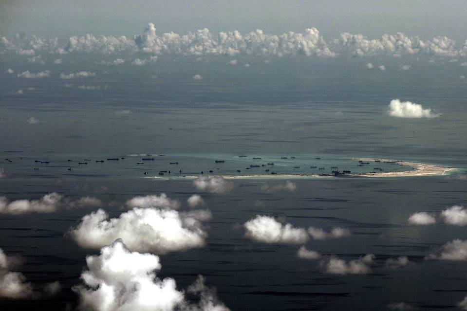 An aerial photo taken from a military plane of land reclamation by China in the Spratly group of islands in the South China Sea, west of Palawan, Philippines, on May 11.