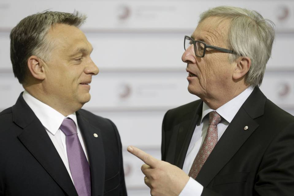 "European Commission President Jean-Claude Juncker, right, was recently overheard jokingly calling Hungarian Prime Minister Viktor Orban, left, ""the dictator."""