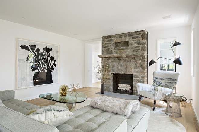 Interior designer Diana Byrne of DB Design kept the colors neutral but the materials and textures varied to give the whole house a streamlined, contemporary look. Shown here is the living room in the front of the house.