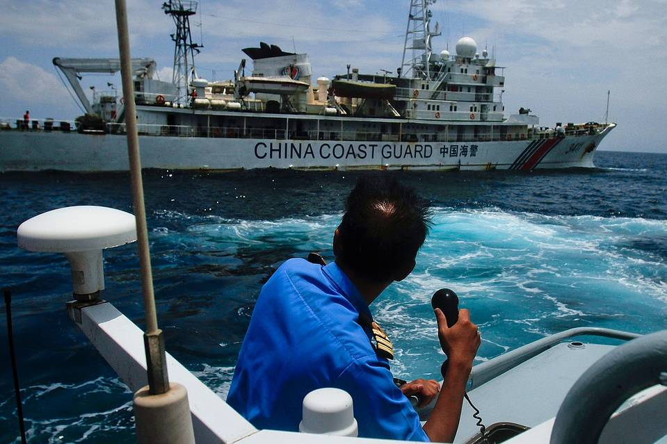 "A Malaysian ship approaches a ship belonging to the Chinese Coast Guard in the South China Sea on March 15, 2014 in Kuantan, Malaysia. Malaysia said Monday it will protest a recent ""intrusion"" of a Chinese Coast Guard ship into its waters north of Borneo."