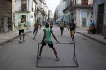 Poor Kids Playing Soccer in the Street
