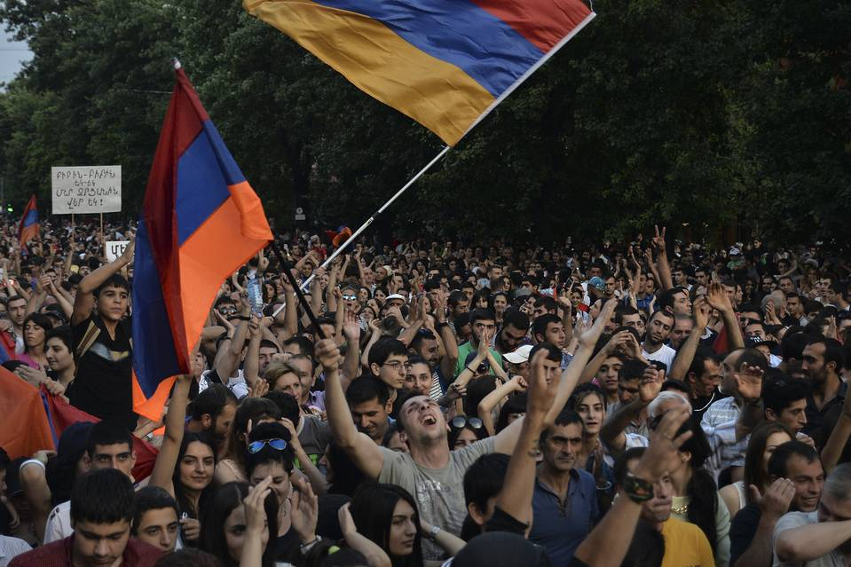 Demonstrators wave national flags during a protest rally against a hike in electricity prices in Yerevan, Armenia on June 27.