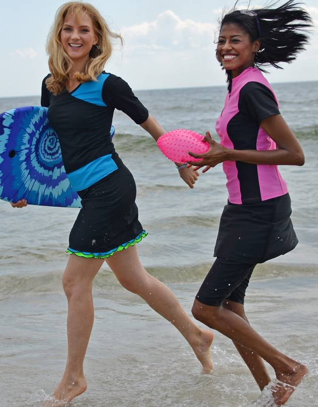 """Two models wear swimsuits by HydroChic on a beach in New York. Several companies now make """"modest"""" swimsuits for women."""