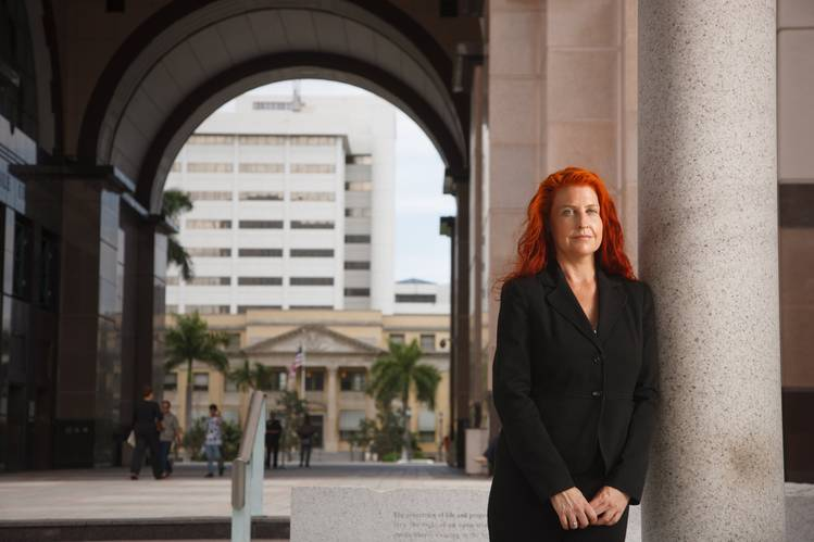 Virginia Murphy, an assistant public defender in West Palm Beach, Fla., has $256,000 in student debt.