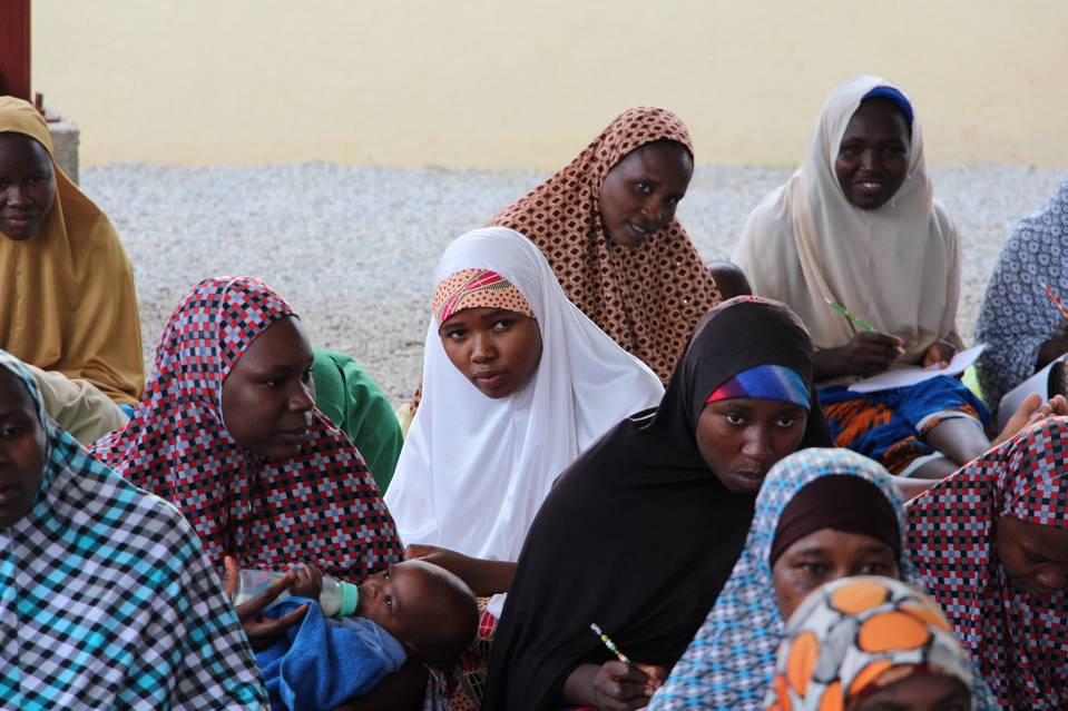 Fatima Bukar, in white, took part in an Arabic lesson at a secret government camp in Nigeria on Aug. 21. Boko Haram held Ms. Bukar and her daughter hostage in a forest clearing for nearly five months.