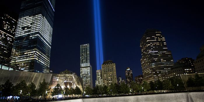 The 9/11 Memorial, with the 'Tribute in Light' nearby, in New York City, Sept. 11, 2014.