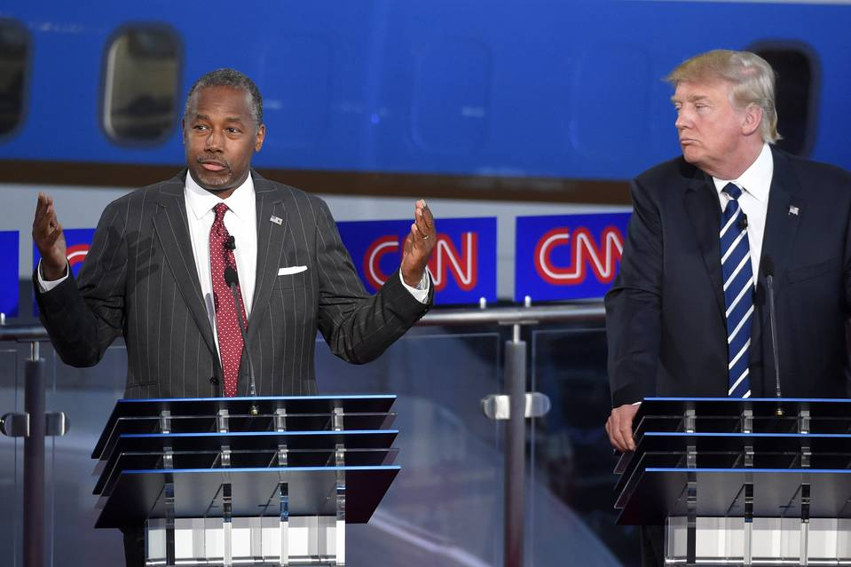 Retired neurosurgeon Ben Carson, left, speaks as Donald Trump looks on during the CNN Republican presidential debate on Sept. 16.