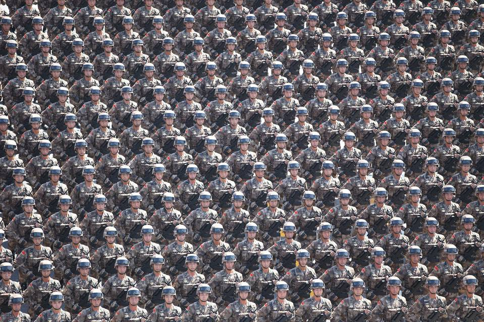 Security researchers have linked a Chinese military staffer to a hacker collective called Naikon. Shown, Chinese soldiers on parade in Beijing earlier this month.