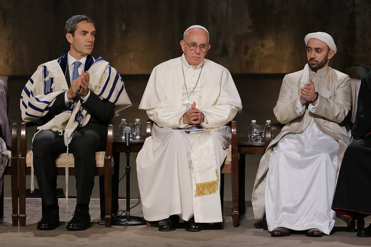 During his recent visit to the U.S., Pope Francis sits with Rabbi Elliot Cosgrove, left, and Imam Khalid Latif, right, during an interfaith ceremony at the National September 11 Memorial and Museum, Sept. 25, New York City.