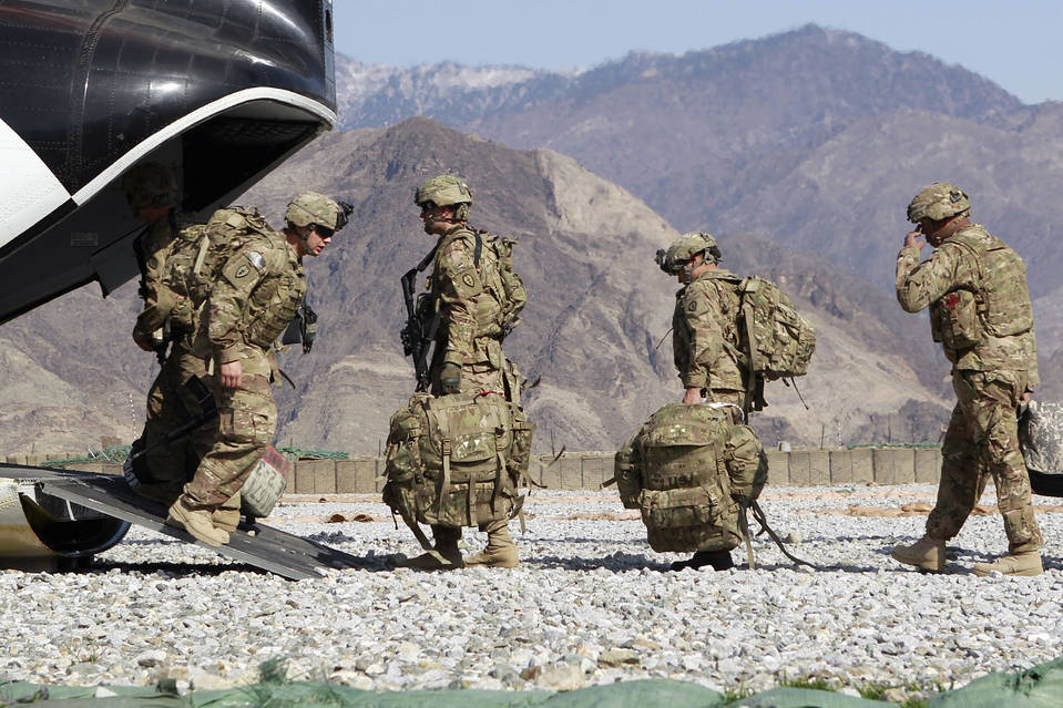 U.S. Army soldiers board a helicopter as they leave after the end of their one-year deployment in Kunar province, eastern Afghanistan, in March 2012.