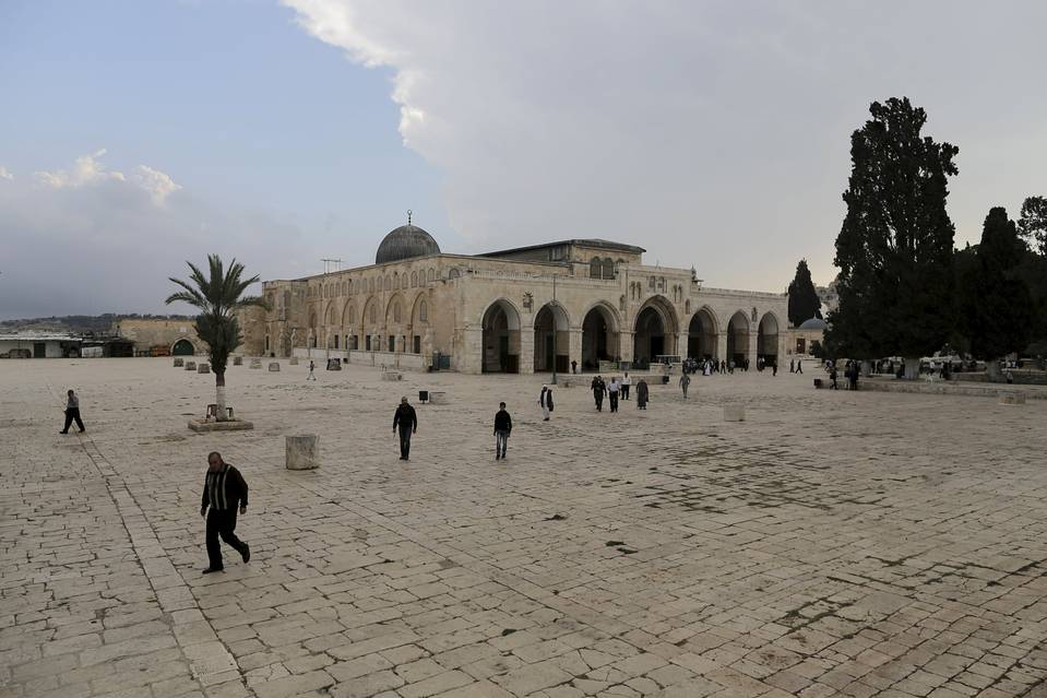 People walk on the compound known to Muslims as the Noble Sanctuary and to Jews as Temple Mount in Jerusalem's Old City on October 26, 2015.