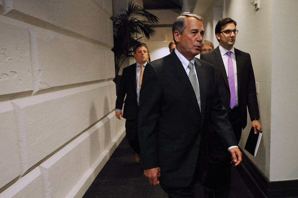 Speaker of the House John Boehner heads to the floor for votes following a GOP conference meeting on Oct. 26