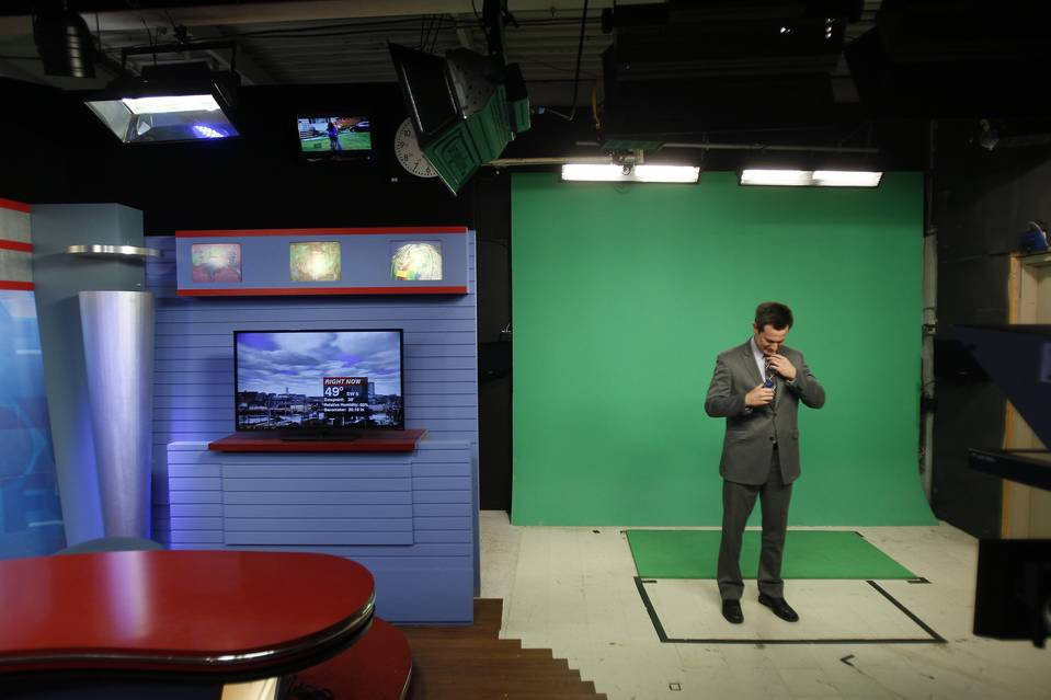 WLIO meteorologist Kyle Adams prepares for a broadcast in Lima, Ohio. The station's nightly news also airs on all three local major-network affiliates.
