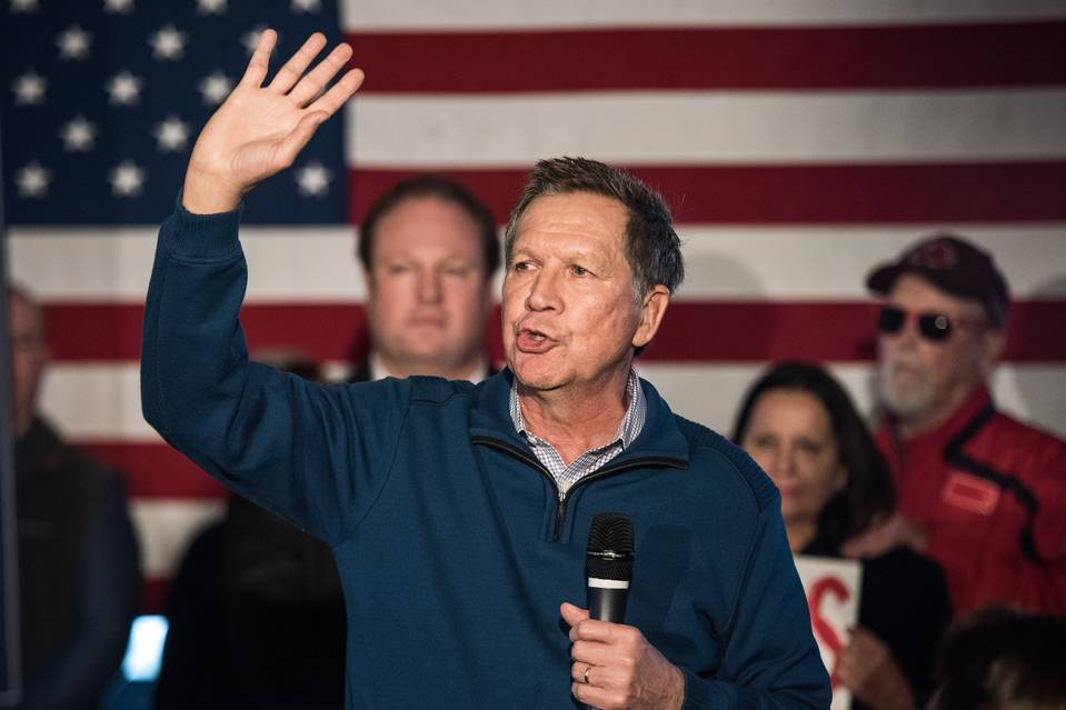 John Kasich talks to the crowd at Finn's Brick Oven Pizza on Wednesday in Mt. Pleasant, S.C.