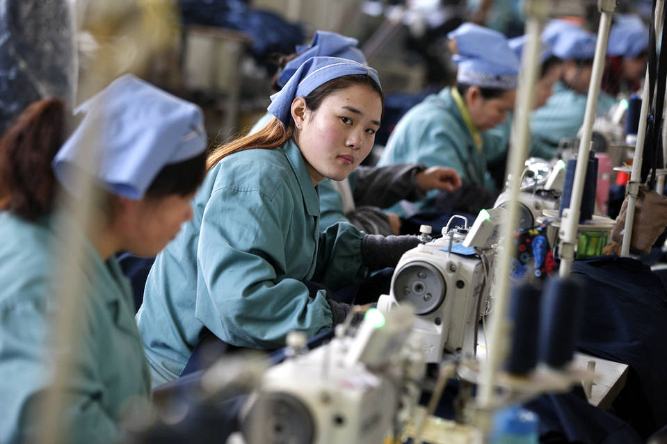 Female laborers work at a cloth factory in Huaibei city, Anhui province, east China on Jan. 19.