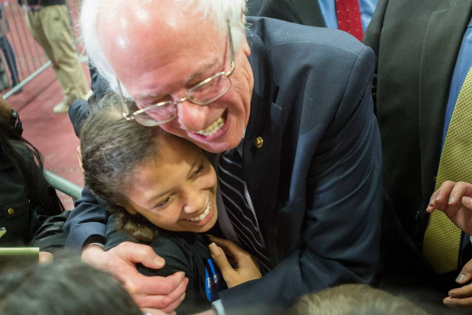 Democratic presidential candidate Bernie Sanders hugs a young supporter at the historically black Claflin University in Orangeburg, S.C. Saturday's primary will show whether the U.S. senator from Vermont can connect with young minority voters.