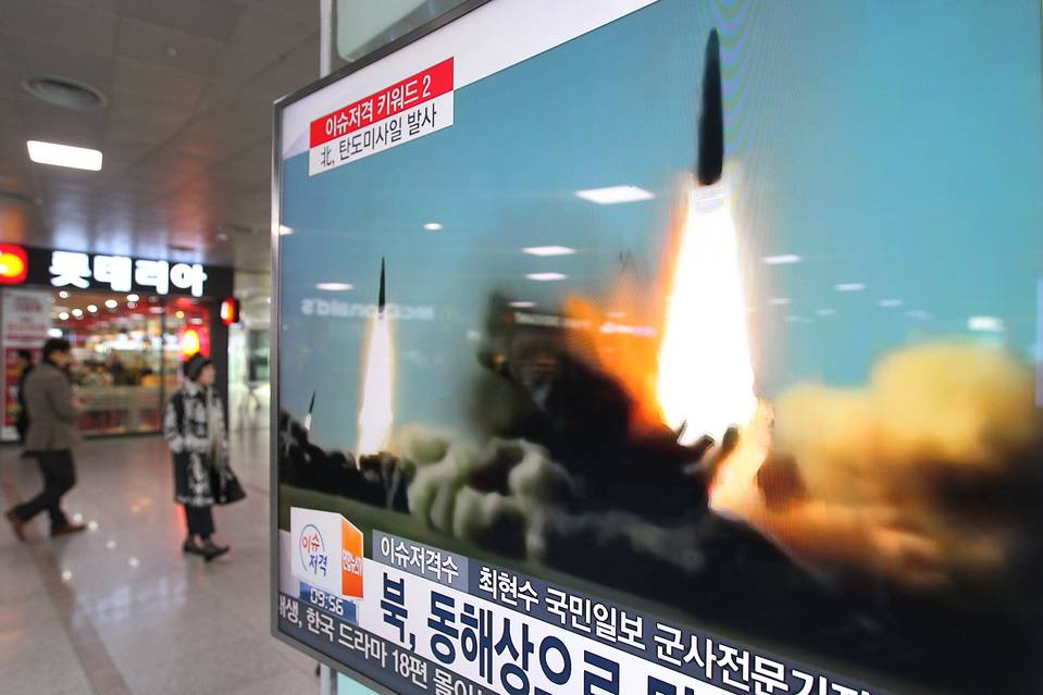 A TV screen at the Seoul Railway Station in South Korea on March 10 shows file footage of a missile launch conducted by Pyongyang. On Wednesday, the U.S. placed fresh sanctions on broad swaths of North Korea's economy in retaliation for nuclear tests.