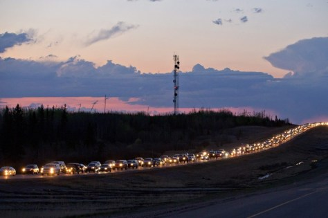 Long traffic lines formed Tuesday outside Fort McMurray as residents were forced to leave.