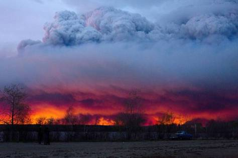 A wildfire moves towards the town of Anzac from Fort McMurray on Wednesday. Alberta declared a state of emergency Wednesday as crews frantically held back wind-whipped wildfires.