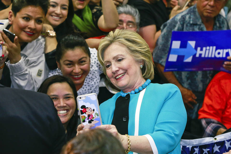 Hillary Clinton takes a photo with supporters at the end of a campaign stop at East Los Angeles College in Los Angeles earlier this month.