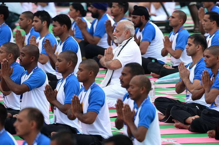 Mr. Modi sat among participants of a mass yoga session held in the northern Indian city of Chandigarh to mark the second international yoga day.