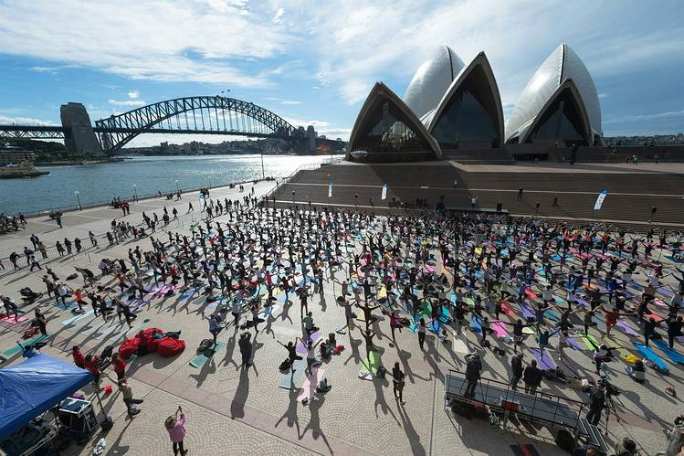 People participated in a yoga event in front of Australia's iconic landmark Opera House in Sydney Tuesday.