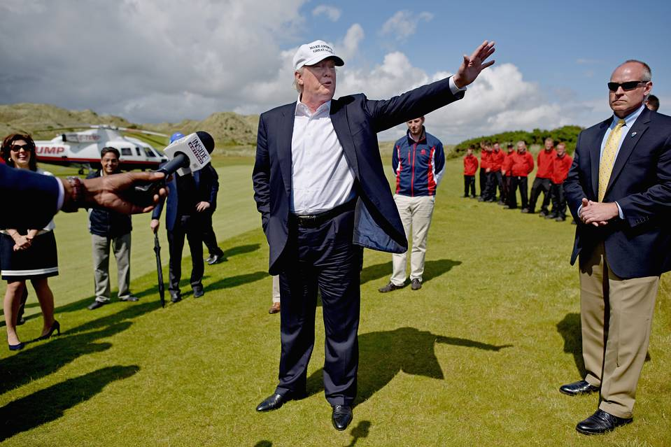 Donald Trump arrives at Trump International Golf Links in Aberdeen, Scotland, on Saturday.