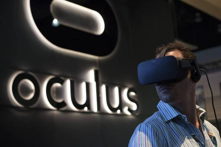 An attendee wears the Oculus Rift headset during the E3 Electronic Entertainment Expo in Los Angeles. PHOTO: BLOOMBERG NEWS