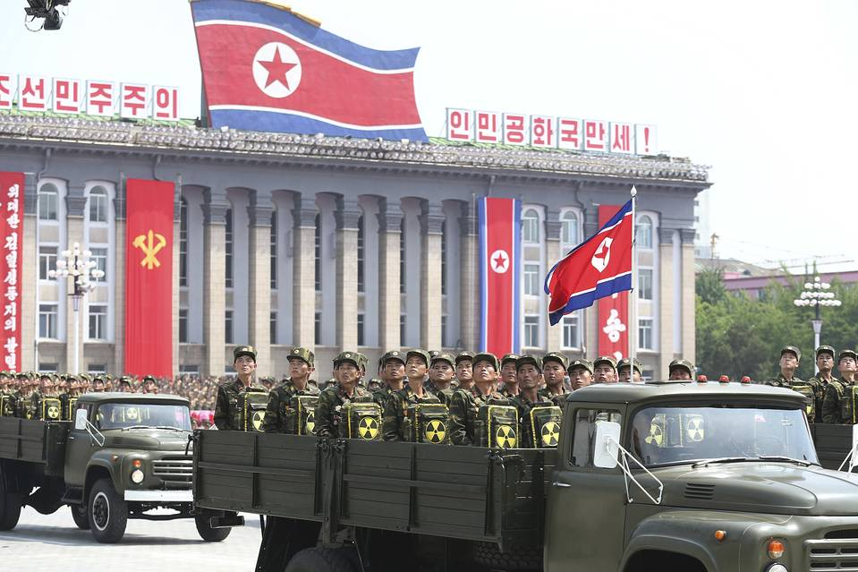 In this July 27, 2013, photo, North Korean soldiers look towards leader Kim Jong Un during a ceremony marking the 60th anniversary of the Korean War armistice in Pyongyang, North Korea.