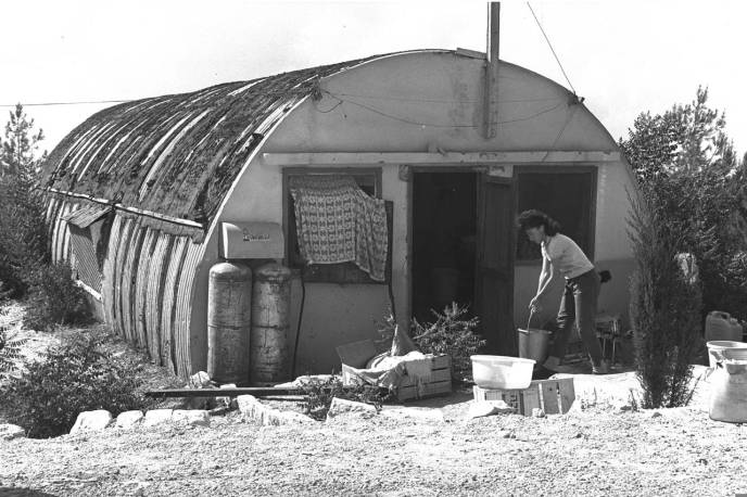 An Israeli settler works in the cookhouse of Kfar Etzion, a settlement in the West Bank near Bethlehem, in the months after the Six Day War of 1967. The cookhouse used to be a barracks for Jordan's Arab Legion.