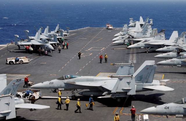 F-18 fighter jets on the deck of USS Carl Vinson during a routine exercise in South China Sea on March 3.