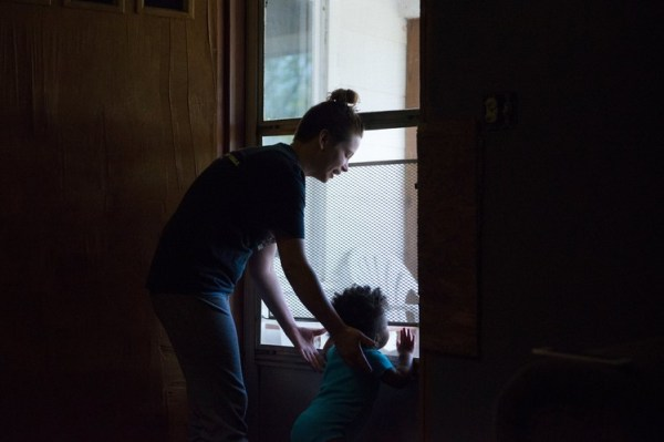 Rhonda Vannoster of Independence, Kan., looks after her 11-month-old daughter Róisin McCoy. She does not own a car and has struggled to find a job.
