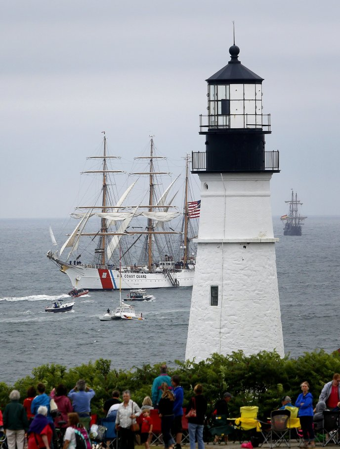 Large crowds gather to watch the Tall Ships Portland parade from Fort Williams Park in Cape Elizabeth, Maine, on July 18, 2015.